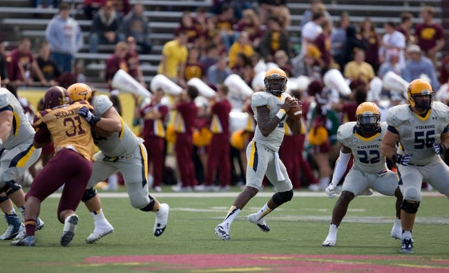 Sep 21, 2013; Mount Pleasant, MI, USA; Toledo Rockets quarterback Terrance Owens (2) drops back to pass against the Central Michigan Chippewas during the second quarter at Kelly/Shorts Stadium. Rockets beat the Chippewas 38-17. Mandatory Credit: Raj Mehta-USA TODAY Sports