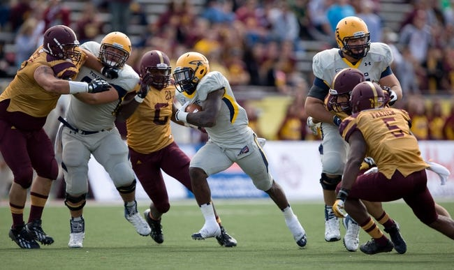 Sep 21, 2013; Mount Pleasant, MI, USA; Toledo Rockets running back David Fluellen (22) runs the ball against the Central Michigan Chippewas during the second quarter at Kelly/Shorts Stadium. Rockets beat the Chippewas 38-17. Mandatory Credit: Raj Mehta-USA TODAY Sports