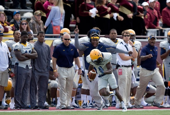 Sep 21, 2013; Mount Pleasant, MI, USA; Toledo Rockets wide receiver Bernard Reedy (1) runs down the sideline during the second quarter against the Central Michigan Chippewas at Kelly/Shorts Stadium. Rockets beat the Chippewas 38-17. Mandatory Credit: Raj Mehta-USA TODAY Sports