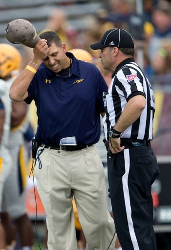 Sep 21, 2013; Mount Pleasant, MI, USA; Toledo Rockets head coach Matt Campbell reacts against the Central Michigan Chippewas during the second quarter at Kelly/Shorts Stadium. Rockets beat the Chippewas 38-17. Mandatory Credit: Raj Mehta-USA TODAY Sports
