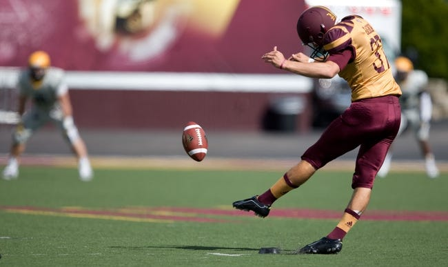 Sep 21, 2013; Mount Pleasant, MI, USA; Central Michigan Chippewas kicker Connor Gagnon (37) kicks off during the first quarter against the Toledo Rockets at Kelly/Shorts Stadium. Rockets beat the Chippewas 38-17. Mandatory Credit: Raj Mehta-USA TODAY Sports