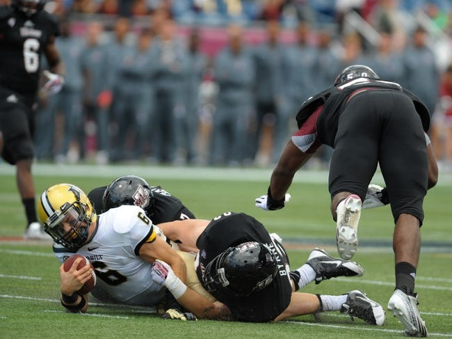 Sep 21, 2013; Foxborough, MA, USA; Vanderbilt Commodores quarterback Austyn Carta-Samuels (6) is tackled by Massachusetts Minutemen defensive lineman Kevin Byrne (93) during the second half at Gillette Stadium. Mandatory Credit: Bob DeChiara-USA TODAY Sports