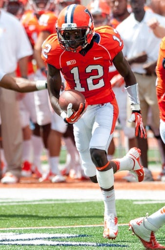 Sep 7, 2013; Champaign, IL, USA; Illinois Fighting Illini wide receiver Ryan Lankford (12) runs for a touchdown against the Cincinnati Bearcats at Memorial Stadium. Mandatory Credit: Bradley Leeb-USA TODAY Sports