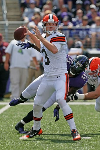 Sep 15, 2013; Baltimore, MD, USA; Cleveland Browns quarterback Brandon Weeden (3) prepares to throw a pass against the Baltimore Ravens at M&T Bank Stadium. Mandatory Credit: Mitch Stringer-USA TODAY Sports