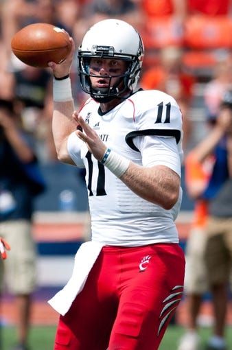 Sep 7, 2013; Champaign, IL, USA; Cincinnati Bearcats quarterback Brendon Kay (11) throws the ball during the game against the Illinois Fighting Illini at Memorial Stadium. Mandatory Credit: Bradley Leeb-USA TODAY Sports