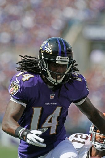 Sep 15, 2013; Baltimore, MD, USA; Baltimore Ravens wide receiver Marlon Brown (14) during the game against the Cleveland Browns at M&T Bank Stadium. Mandatory Credit: Mitch Stringer-USA TODAY Sports