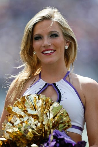 Sep 15, 2013; Baltimore, MD, USA; Baltimore Ravens cheerleaders entertain fans prior to the game against the Cleveland Browns at M&T Bank Stadium. Mandatory Credit: Mitch Stringer-USA TODAY Sports