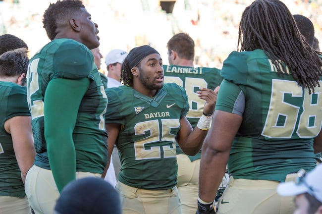 Sep 21, 2013; Waco, TX, USA; Baylor Bears offensive linesman Tre'Von Armstead (72) and running back Lache Seastrunk (25) and guard Cyril Richardson (68) during the game against the Louisiana Monroe Warhawks at Floyd Casey Stadium. The Bears defeated the Warhawks 70-7. Mandatory Credit: Jerome Miron-USA TODAY Sports