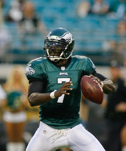 Aug 24, 2013; Jacksonville, FL, USA; Philadelphia Eagles quarterback Michael Vick (7) looks for a receiver during the first quarter of their game against the Jacksonville Jaguars at EverBank Field. The Philadelphia Eagles beat the Jacksonville Jaguars 31-24. Mandatory Credit: Phil Sears-USA TODAY Sports