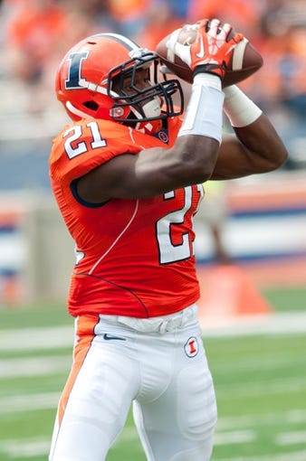 Sep 7, 2013; Champaign, IL, USA; Illinois Fighting Illini wide receiver Devin Church (21) makes a catch during the game against the Cincinnati Bearcats at Memorial Stadium. Mandatory Credit: Bradley Leeb-USA TODAY Sports
