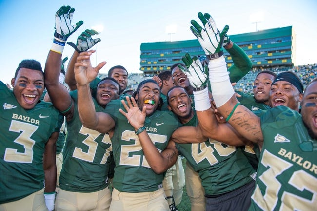 Sep 21, 2013; Waco, TX, USA; Baylor Bears wide receiver Robbie Rhodes (3) and cornerback Josh Benenoch (37) and running back Lache Seastrunk (25) and linebacker Travon Blanchard (48) celebrates the win over the Louisiana Monroe Warhawks at Floyd Casey Stadium. The Bears defeated the Warhawks 70-7. Mandatory Credit: Jerome Miron-USA TODAY Sports