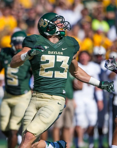 Sep 21, 2013; Waco, TX, USA; Baylor Bears wide receiver Clay Fuller (23) during the game against the Louisiana Monroe Warhawks at Floyd Casey Stadium. The Bears defeated the Warhawks 70-7. Mandatory Credit: Jerome Miron-USA TODAY Sports