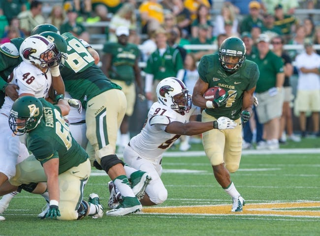 Sep 21, 2013; Waco, TX, USA; Baylor Bears running back Anthony Webb (14) eludes Louisiana Monroe Warhawks defensive end Diontre Thomas (97) during the game at Floyd Casey Stadium. The Bears defeated the Warhawks 70-7. Mandatory Credit: Jerome Miron-USA TODAY Sports