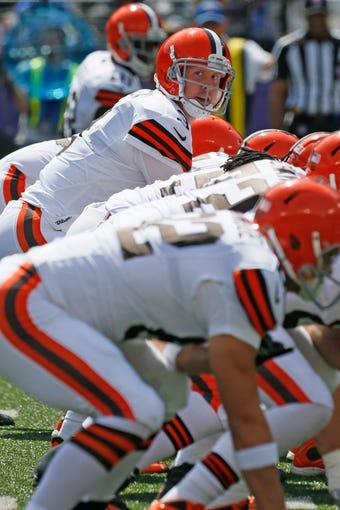 Sep 15, 2013; Baltimore, MD, USA; Cleveland Browns quarterback Brandon Weeden (3) calls signals during the game against the Baltimore Ravens at M&T Bank Stadium. Mandatory Credit: Mitch Stringer-USA TODAY Sports