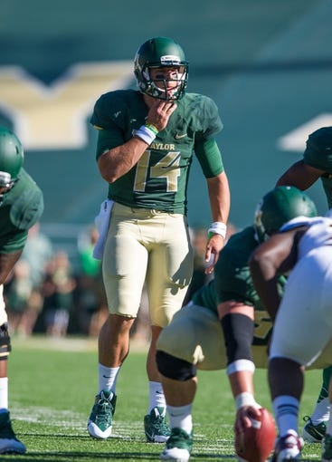 Sep 21, 2013; Waco, TX, USA; Baylor Bears quarterback Bryce Petty (14) during the game against the Louisiana Monroe Warhawks at Floyd Casey Stadium. The Bears defeated the Warhawks 70-7. Mandatory Credit: Jerome Miron-USA TODAY Sports