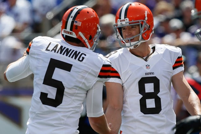 Sep 15, 2013; Baltimore, MD, USA; Cleveland Browns kicker Billy Cundiff (8) is congratulated by holder Spencer Lanning (5) after making a field goal against the Baltimore Ravens at M&T Bank Stadium. Mandatory Credit: Mitch Stringer-USA TODAY Sports