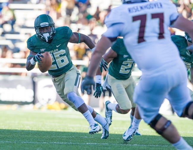Sep 21, 2013; Waco, TX, USA; Baylor Bears safety Taion Sells (26) returns an interception against the Louisiana Monroe Warhawks during the game at Floyd Casey Stadium. The Bears defeated the Warhawks 70-7. Mandatory Credit: Jerome Miron-USA TODAY Sports