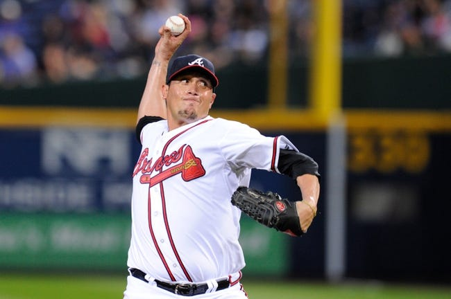 Sep 24, 2013; Atlanta, GA, USA; Atlanta Braves starting pitcher Freddy Garcia (50) pitches against the Milwaukee Brewers against the during the first inning at Turner Field. Mandatory Credit: Dale Zanine-USA TODAY Sports