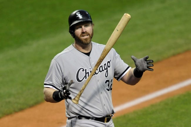 Sep 24, 2013; Cleveland, OH, USA; Chicago White Sox first baseman Adam Dunn (32) reacts after striking out in the second inning against the Cleveland Indians at Progressive Field. Mandatory Credit: David Richard-USA TODAY Sports
