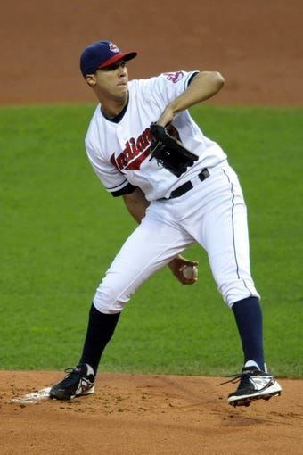 Sep 24, 2013; Cleveland, OH, USA; Cleveland Indians starting pitcher Ubaldo Jimenez (30) delivers in the first inning against the Chicago White Sox at Progressive Field. Mandatory Credit: David Richard-USA TODAY Sports