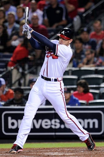 Sep 24, 2013; Atlanta, GA, USA; Atlanta Braves first baseman Freddie Freeman (5) gets a base hit against the Milwaukee Brewers during the fourth inning at Turner Field. Mandatory Credit: Dale Zanine-USA TODAY Sports