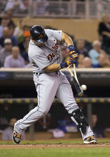 Sep 24, 2013; Minneapolis, MN, USA; Detroit Tigers third baseman Miguel Cabrera (24) swings and breaks his bat in the first inning against the Minnesota Twins at Target Field. Mandatory Credit: Jesse Johnson-USA TODAY Sports