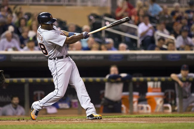 Sep 24, 2013; Minneapolis, MN, USA; Detroit Tigers right fielder Torii Hunter (48) hits a single in the first inning against the Minnesota Twins at Target Field. Mandatory Credit: Jesse Johnson-USA TODAY Sports
