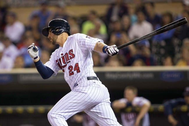 Sep 24, 2013; Minneapolis, MN, USA; Minnesota Twins third baseman Trevor Plouffe (24) hits a single in the first inning against the Detroit Tigers at Target Field. Mandatory Credit: Jesse Johnson-USA TODAY Sports