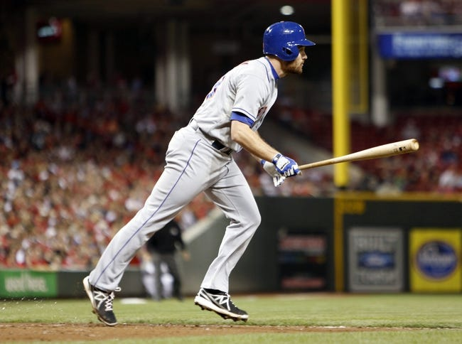 Sep 24, 2013; Cincinnati, OH, USA; New York Mets second baseman Daniel Murphy watches his three-run home run hit off Cincinnati Reds starting pitcher Mike Leake (not pictured) in the second inning at Great American Ball Park. Mandatory Credit: David Kohl-USA TODAY Sports