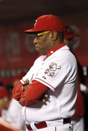 Sep 24, 2013; Cincinnati, OH, USA; Cincinnati Reds manager Dusty Baker watches from the dugout in the second inning during a game against the New York Mets at Great American Ball Park. Mandatory Credit: David Kohl-USA TODAY Sports