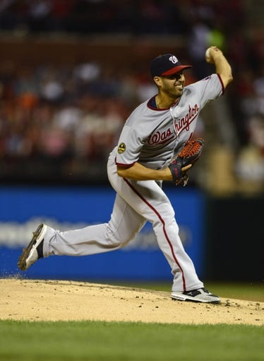 Sep 24, 2013; St. Louis, MO, USA; Washington Nationals starting pitcher Gio Gonzalez (47) throws to a St. Louis Cardinals batter during the first inning at Busch Stadium. Mandatory Credit: Jeff Curry-USA TODAY Sports