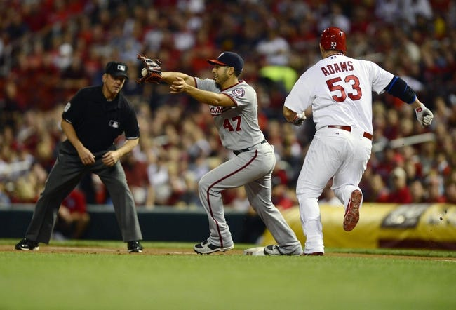 Sep 24, 2013; St. Louis, MO, USA; Washington Nationals starting pitcher Gio Gonzalez (47) receives the throw and forces out St. Louis Cardinals first baseman Matt Adams (53) during the first inning at Busch Stadium. Mandatory Credit: Jeff Curry-USA TODAY Sports