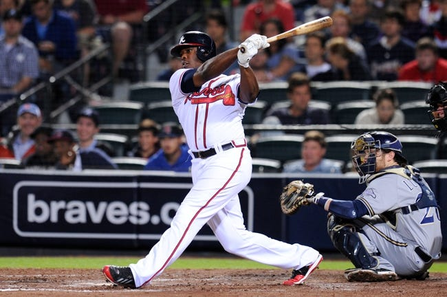 Sep 24, 2013; Atlanta, GA, USA; Atlanta Braves right fielder Justin Upton (8) gets a base hit against the Milwaukee Brewers during the sixth inning at Turner Field. Mandatory Credit: Dale Zanine-USA TODAY Sports
