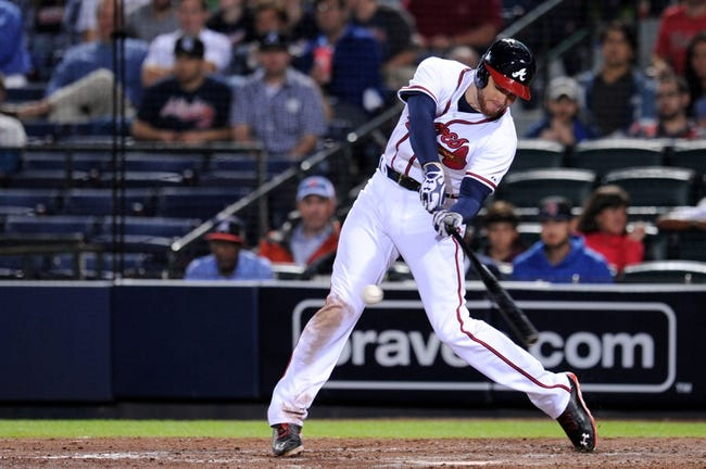 Sep 24, 2013; Atlanta, GA, USA; Atlanta Braves first baseman Freddie Freeman (5) drives in a run with a base hit against the Milwaukee Brewers during the sixth inning at Turner Field. Mandatory Credit: Dale Zanine-USA TODAY Sports