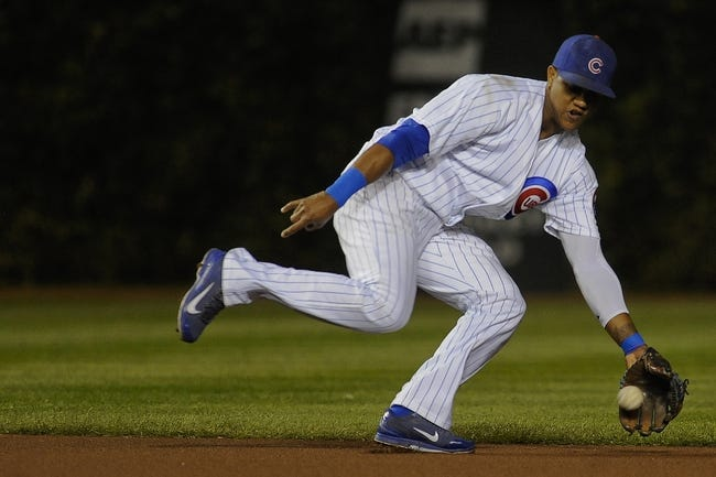 Sep 24, 2013; Chicago, IL, USA;  Chicago Cubs infielder Starlin Castro stops a ball against the Pittsburgh Pirates in the first inning at Wrigley Field. Mandatory Credit: Matt Marton-USA TODAY Sports