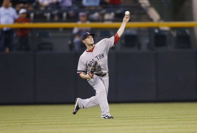 Sep 24, 2013; Denver, CO, USA; Boston Red Sox left fielder Daniel Nava (29) fields a fly ball during the first inning against the Colorado Rockies at Coors Field. Mandatory Credit: Chris Humphreys-USA TODAY Sports