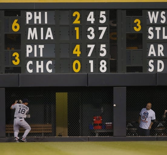Sep 24, 2013; Denver, CO, USA; Boston Red Sox right fielder Shane Victorino (18) runs up against the wall attempting to field a fly ball during the first inning against the Colorado Rockies at Coors Field.  Mandatory Credit: Chris Humphreys-USA TODAY Sports