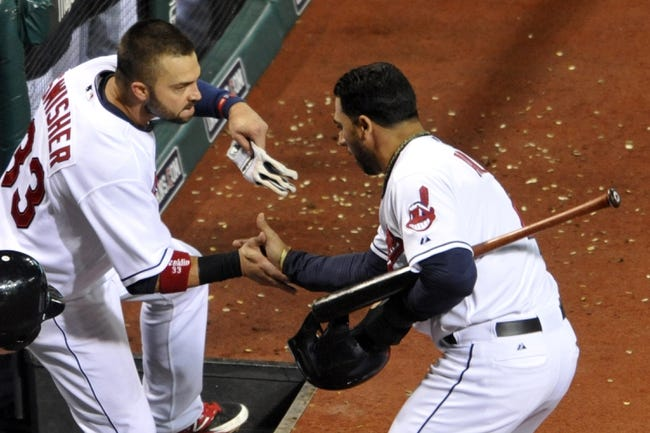 Sep 24, 2013; Cleveland, OH, USA; Cleveland Indians shortstop Mike Aviles (right) is congratulated by first baseman Nick Swisher (33) after scoring in the seventh inning against the Chicago White Sox at Progressive Field. Mandatory Credit: David Richard-USA TODAY Sports