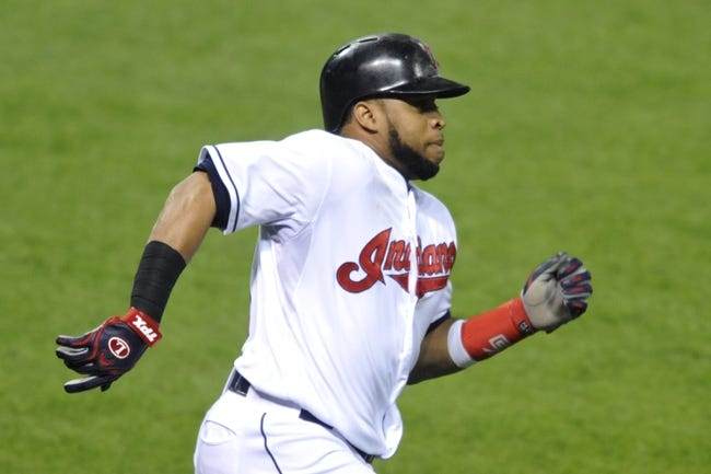 Sep 24, 2013; Cleveland, OH, USA; Cleveland Indians designated hitter Carlos Santana (41) runs out a double in the sixth inning against the Chicago White Sox at Progressive Field. Mandatory Credit: David Richard-USA TODAY Sports