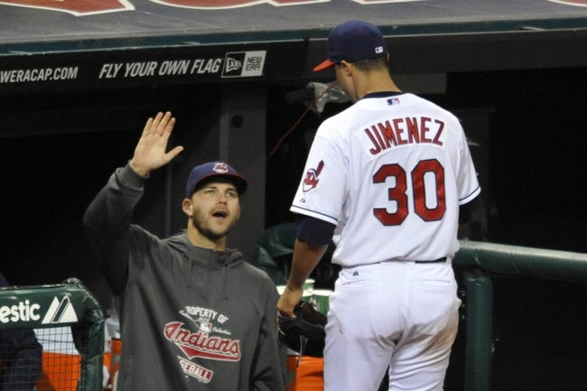 Sep 24, 2013; Cleveland, OH, USA; Cleveland Indians starting pitcher Ubaldo Jimenez (30) is congratulated by starting pitcher Justin Masterson in the seventh inning against the Chicago White Sox at Progressive Field. Mandatory Credit: David Richard-USA TODAY Sports