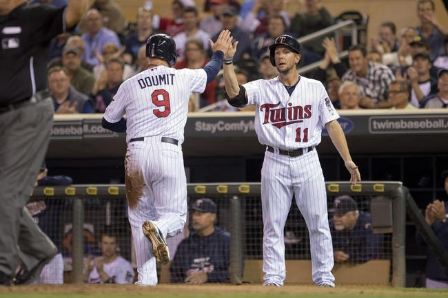 Sep 24, 2013; Minneapolis, MN, USA; Minnesota Twins right fielder Ryan Doumit (9) celebrates with left fielder Clete Thomas (11) after scoring a run in the second inning against the Detroit Tigers at Target Field. Mandatory Credit: Jesse Johnson-USA TODAY Sports