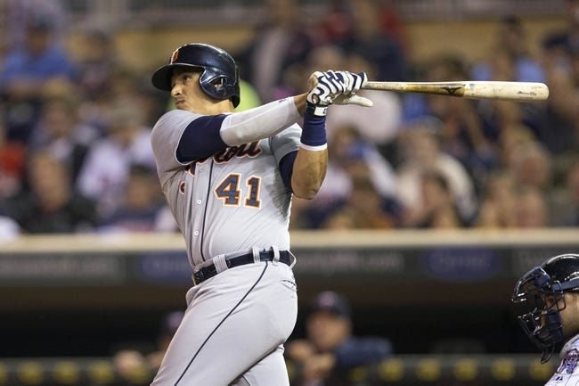 Sep 24, 2013; Minneapolis, MN, USA; Detroit Tigers designated hitter Victor Martinez (41) hits a home run in the fourth inning against the Minnesota Twins at Target Field. Mandatory Credit: Jesse Johnson-USA TODAY Sports