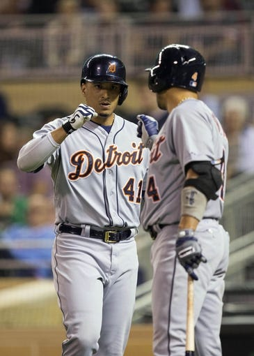 Sep 24, 2013; Minneapolis, MN, USA; Detroit Tigers designated hitter Victor Martinez (41) celebrates with second baseman Omar Infante (4) after hitting a home run in the fourth inning against the Minnesota Twins at Target Field. Mandatory Credit: Jesse Johnson-USA TODAY Sports