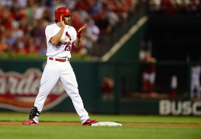 Sep 24, 2013; St. Louis, MO, USA; St. Louis Cardinals second baseman Matt Carpenter (13) celebrates after hitting a double off of Washington Nationals starting pitcher Gio Gonzalez (not pictured) during the third inning at Busch Stadium. Mandatory Credit: Jeff Curry-USA TODAY Sports