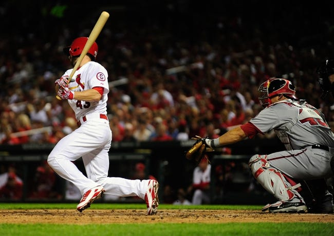 Sep 24, 2013; St. Louis, MO, USA; St. Louis Cardinals left fielder Shane Robinson (43) hits a one run single off of Washington Nationals starting pitcher Gio Gonzalez (not pictured) during the third inning at Busch Stadium. Mandatory Credit: Jeff Curry-USA TODAY Sports