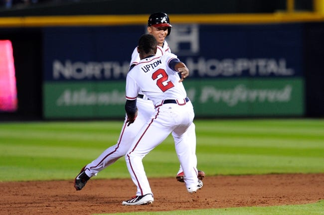 Sep 24, 2013; Atlanta, GA, USA; Atlanta Braves shortstop Andrelton Simmons (19) reacts with B.J. Upton (2) after getting the game hit against the Milwaukee Brewers during the ninth inning at Turner Field. The Braves defeated the Brewers 3-2. Mandatory Credit: Dale Zanine-USA TODAY Sports