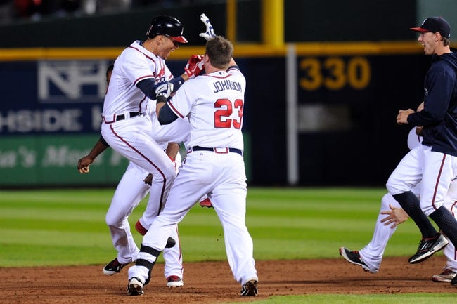 Sep 24, 2013; Atlanta, GA, USA; Atlanta Braves shortstop Andrelton Simmons (19) reacts with Chris Johnson (23) after getting the game hit against the Milwaukee Brewers during the ninth inning at Turner Field. The Braves defeated the Brewers 3-2. Mandatory Credit: Dale Zanine-USA TODAY Sports