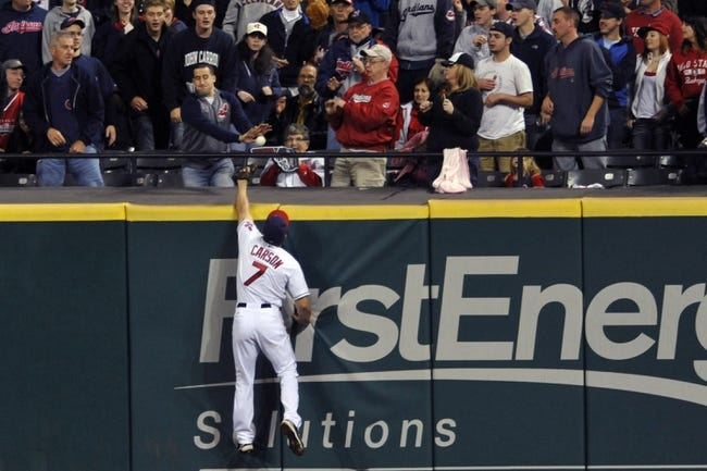 Sep 24, 2013; Cleveland, OH, USA; Cleveland Indians right fielder Matt Carson (7) reaches for a solo home run by Chicago White Sox center fielder Alejandro De Aza (not pictured) in the ninth inning at Progressive Field. Mandatory Credit: David Richard-USA TODAY Sports