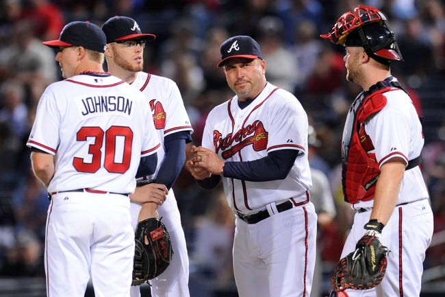 Sep 24, 2013; Atlanta, GA, USA; Atlanta Braves third baseman Elliot Johnson (30) first baseman Freddie Freeman (5) manager Fredi Gonzalez (33) and catcher Brian McCann (16) (left to right) shown on the pitchers mound against the Milwaukee Brewers during the eighth inning at Turner Field. The Braves defeated the Brewers 3-2. Mandatory Credit: Dale Zanine-USA TODAY Sports