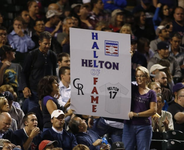 Sep 24, 2013; Denver, CO, USA; A fan holds a sign honoring Colorado Rockies first baseman Todd Helton (not pictured) during the fourth inning against the Boston Red Sox at Coors Field. Mandatory Credit: Chris Humphreys-USA TODAY Sports